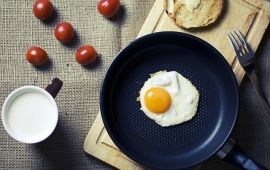egg in skillet and breakfast foods