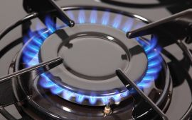 Close up of burner on a gas stovetop