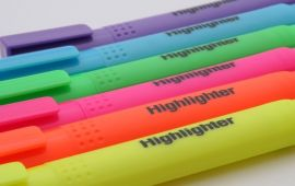 Multiple colors of highlighter pens lined up together.