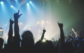 silhouette of audience at rock concert, hands in air