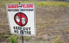 danger pesticides sign in field