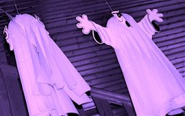pink sheets hanging like ghosts