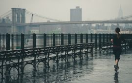 female runner with Brooklyn Bridge in background