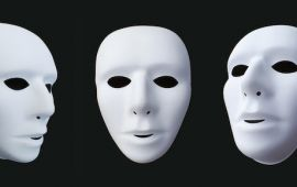 trio of three white, neutral masks on black background