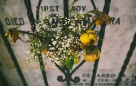 bouquet of wilted yellow flowers at grave