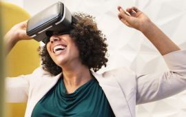 Happy woman with Virtual Reality headset