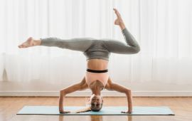 Woman on her head in headstand yoga inversion pose.
